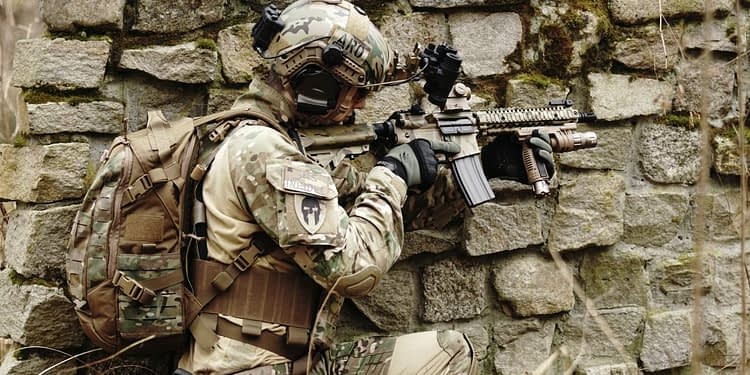 military hiding on wall